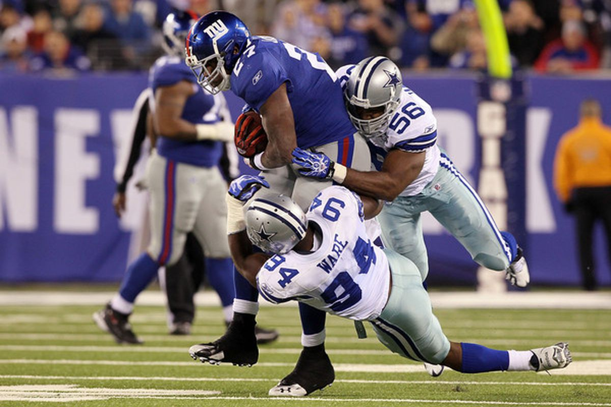 Defensive mad man DeMarcus Ware gets help from Bradie James. Throw in Jay Ratliff and you might have a picture of the only Cowboys defensive players that are worth any accolades at all.