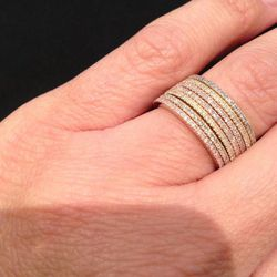 Bank models her boutique's Thin Diamond Stacking Bands, $800