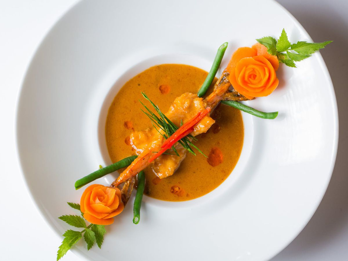 An elegantly plated dish of Thai food.
