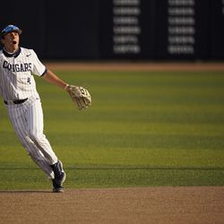 BYU's Andrew Pintar signals a popup during games against Portland in Provo, Utah.