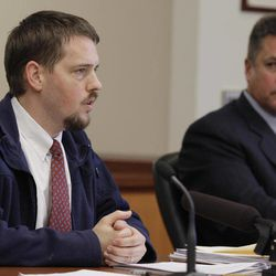 Josh Powell, left, the husband of missing Utah woman Susan Powell, speaks as John Long, assistant attorney general for Washington state, looks on at right, during a court hearing regarding the custody of Powell's two sons, Wednesday, Sept. 28, 2011, in Tacoma, Wash. A judge later awarded temporary custody of the boys to Susan Powell's parents, Chuck Cox and his wife Judy.