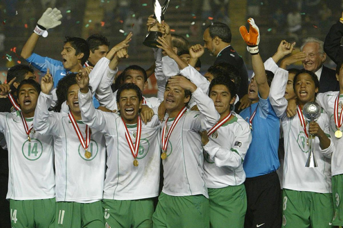 Mexican soccer players celebrate their F