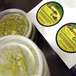 Tubs of guacamole await labels.