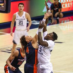 Brigham Young Cougars forward Gideon George (5) shoots the ball over Pepperdine Waves guard Colbey Ross (4) at the Marriott Center in Provo on Saturday, Jan. 23, 2021.