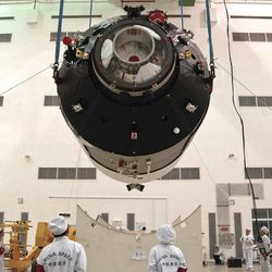 Researchers installing China's first space station module Tiangong-1.   Color China Photo via AP file photo