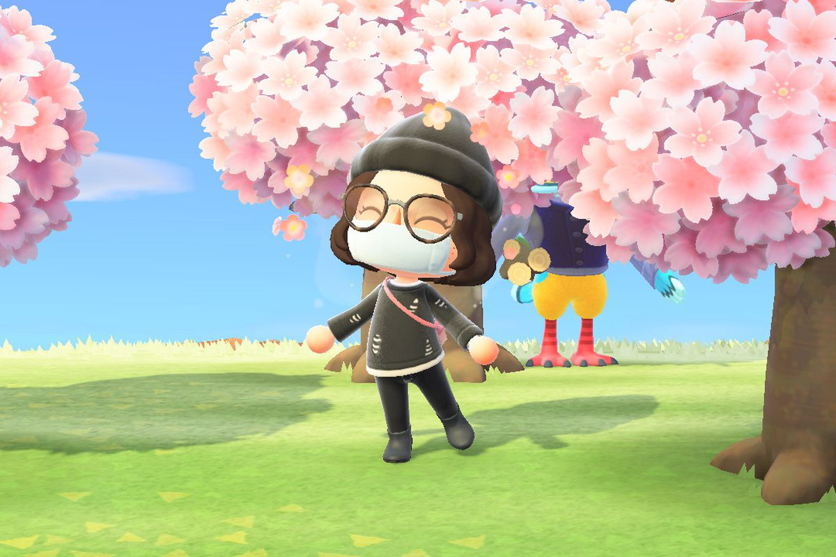 An Animal Crossing human wearing all black and standing in front of some cherry blossom trees and an eagle named Keaton