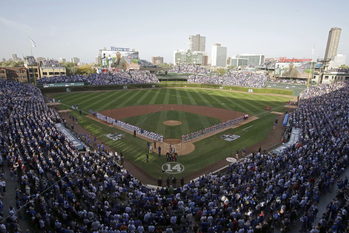 The Chicago Cubs and St. Louis Cardinals at Wrigley Field during the national anthem before Game 3 in baseball's National League Division Series in 2015.