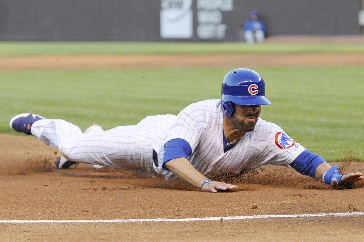 David DeJesus of the Chicago Cubs slides safely into third base against the Philadelphia Phillies at Wrigley Field in Chicago, Illinois.  (Photo by David Banks/Getty Images)