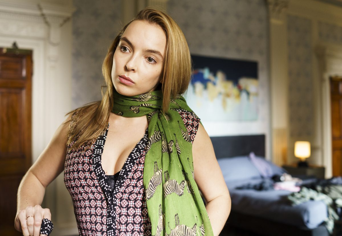 Villanelle tries on Eve's scarf, which she stole. Image: BBC America
