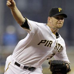 Pittsburgh Pirates pitcher A.J. Burnett throws in the first inning against the St. Louis Cardinals during a baseball game in Pittsburgh Saturday, April 21, 2012.