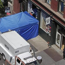 Federal Bureau of Investigation and NYPD law enforcement officials search a SoHo basement at the corner of Wooster and Prince streets for the possible remains of missing child Etan Patz as part of a decades-old investigation into the disappearance of Patz, on Thursday, April 19, 2012 in New York. Etan was last seen near the search location on his way to school in 1979.