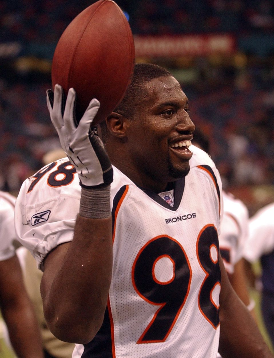 NEW ORLEANS,LA--NOVEMBER 21TH 2004--Reggie Hayward keeps the football in celebration after making an interception against New Orleans Saints at the Louisiana Superdome late in the fourth quarter of play Sunday afternoon. THE DENVER POST/ ANDY CROSS