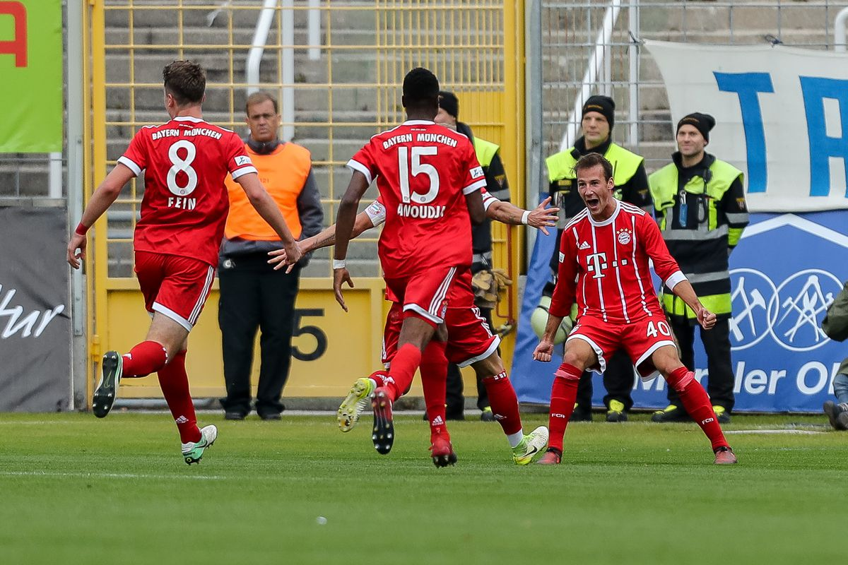 MUNICH, GERMANY - OCTOBER 22: Fabian Benko of Bayern Muenchen celebrates after scoring his team`s first goal with team mates during the match between TSV 1860 Muenchen and Bayern Muenchen II at Stadion an der Grünwalder Straße on October 22, 2017 in Munich, Germany.