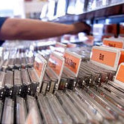 Wholesale prices for most CDs from Universal Music Group will be trimmed to $9.09, and many stores will pass savings along.