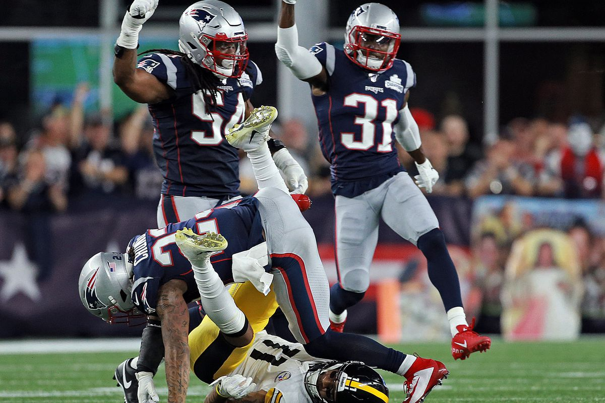Patrick Chung #23 of the New England Patriots keeps Donte Moncrief #11 of the Pittsburgh Steelers from making a fourth quarter reception as Dont'a Hightower #54 and Jonathan Jones #31celebrate during the second quarter of the NFL game at Gillette Stadium on September 8, 2019 in Foxboro, Massachusetts.