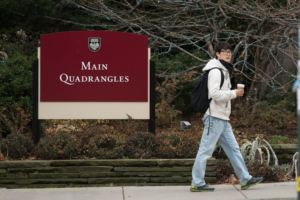 A pedestrian walks past an entrance to the main quadrangles on the Hyde Park campus of the University of Chicago. The university announced Thursday that it had received its largest ever estate gift. | Sun-Times file photo.