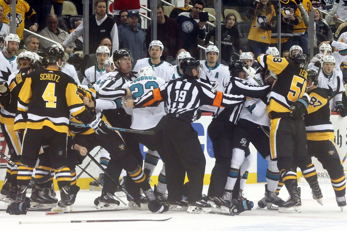 Feb 21, 2019; Pittsburgh, PA, USA; The San Jose Sharks and the Pittsburgh Penguins fight during a third period timeout at PPG PAINTS Arena. San Jose shutout the Penguins 4-0.