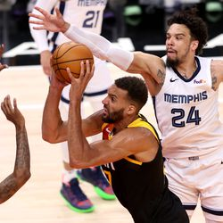 Utah Jazz center Rudy Gobert (27) pushes up a shot with Memphis Grizzlies guard Ja Morant (12) and Memphis Grizzlies forward Dillon Brooks (24) defending him as the Utah Jazz and the Memphis Grizzlies play in game 5 at Vivint Arena in Salt Lake City on Wednesday, June 2, 2021. Utah won 126-110, Utah advances to the second round.