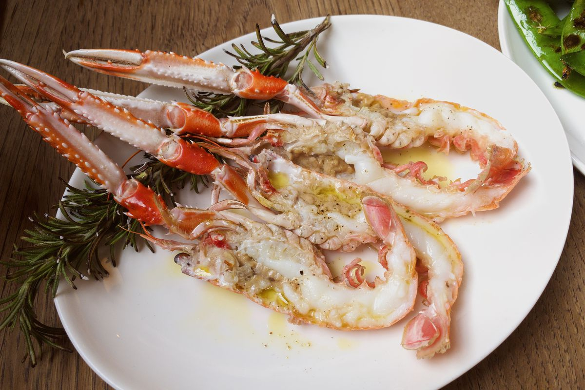 Langoustines on a white platter with rosemary at Brat