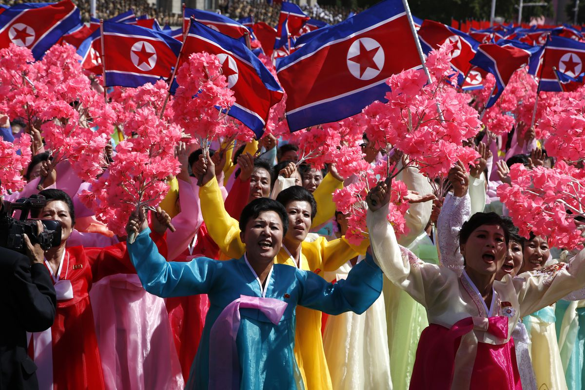 Participants cheer as they take part in a parade for the 70th anniversary of North Korea's founding day in Pyongyang, North Korea on Sunday, September 9, 2018.