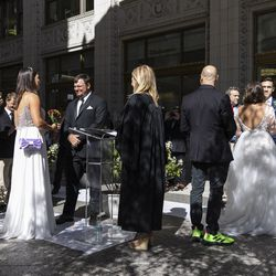 Couples stand at the altar outside the Wrigley Building on N Michigan Ave during the Meet Me on The Mile Sunday Spectacle Sunday, Sept. 26, 2021. 50 couples were married outside the Wrigley Building during The Mile Sunday Spectacle. | Anthony Vazquez/Sun-Times