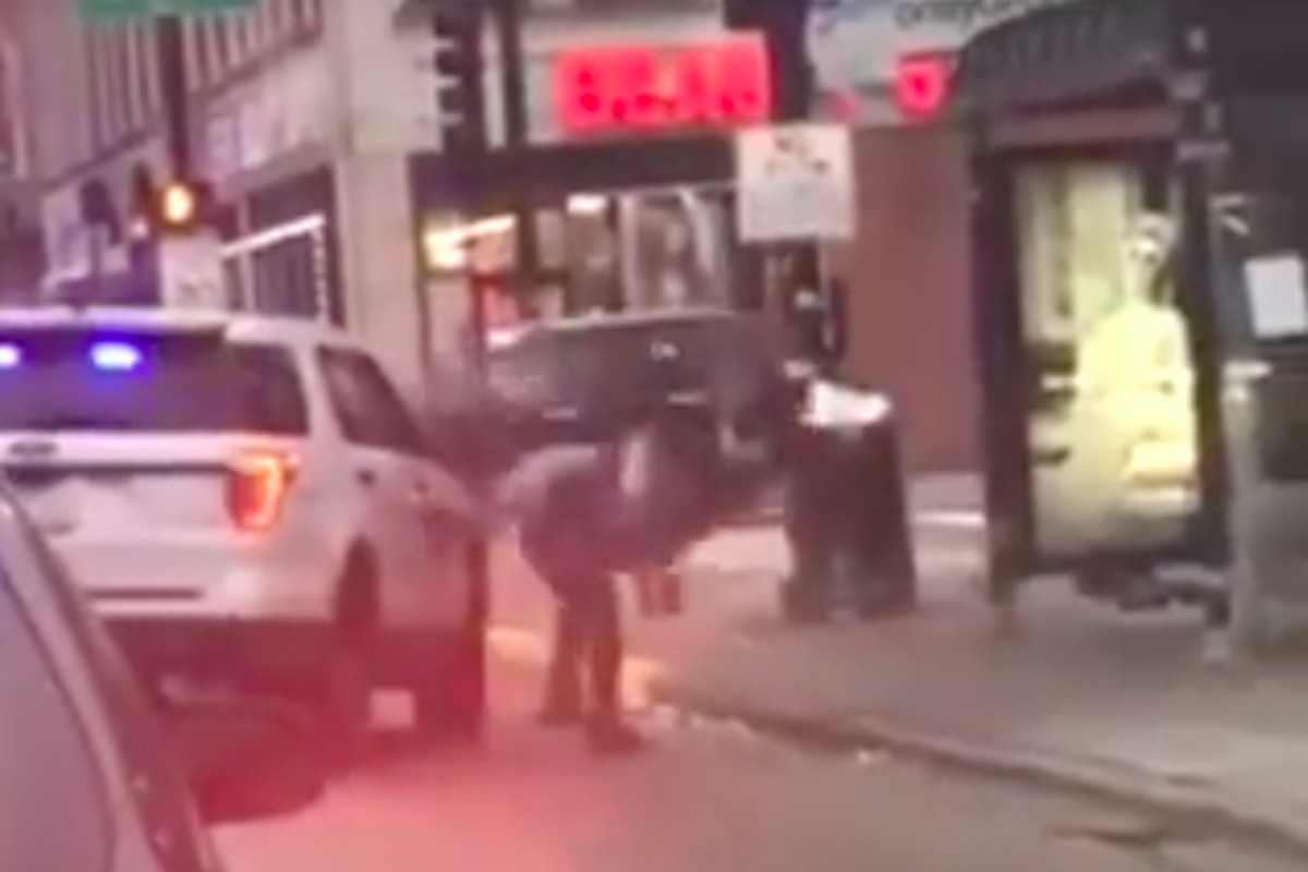 An image taken from a cellphone video that was posted to social media Nov. 28, 2019, shows a Chicago police officer lift a man off his feet and slam him to the ground after he allegedly spit on the officer while being detained for drinking in public.