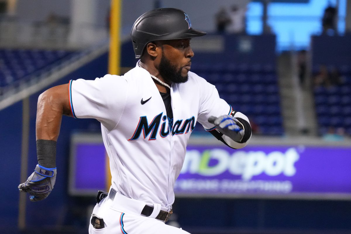 Starling Marte #6 of the Miami Marlins singles on a soft ground ball in the first inning against the Toronto Blue Jays at loanDepot park