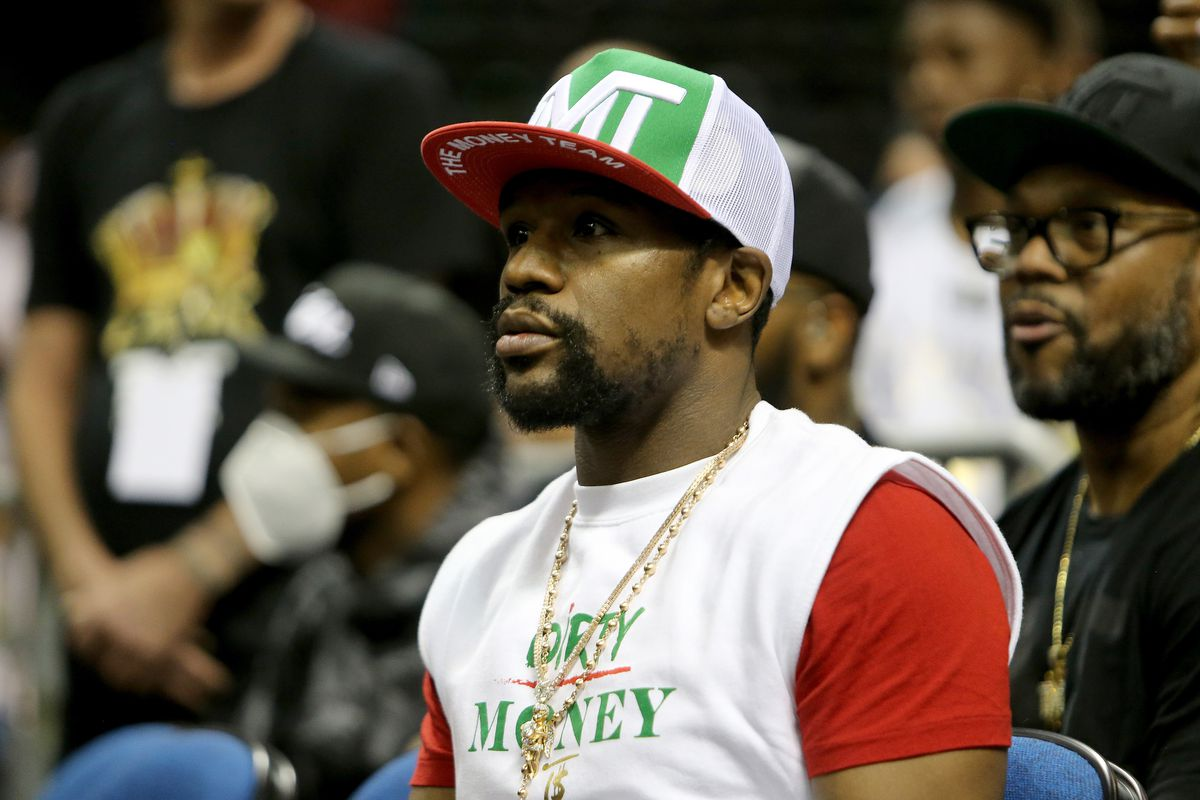 World champion boxer Floyd Mayweather Jr. sits ringside during the Fight Night in Daytona Beach boxing event at the Ocean Center on November 20, 2020 in Daytona Beach, Florida.