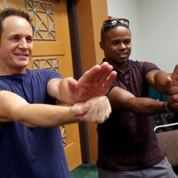 """David Yost and Walter Jones, who were both in """"The Mighty Morphin' Power Rangers,"""" strike a pose during a press conference at Utah's first Comic Con at the Salt Palace Convention Center in Salt Lake City on Thursday, Sept. 5, 2013."""