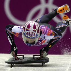 Noelle Pikus-Pace of the United States starts her final run during the women's skeleton competition at the 2014 Winter Olympics, Friday, Feb. 14, 2014, in Krasnaya Polyana, Russia. Pikus-Pace won the silver medal. (AP Photo/Natacha Pisarenko)