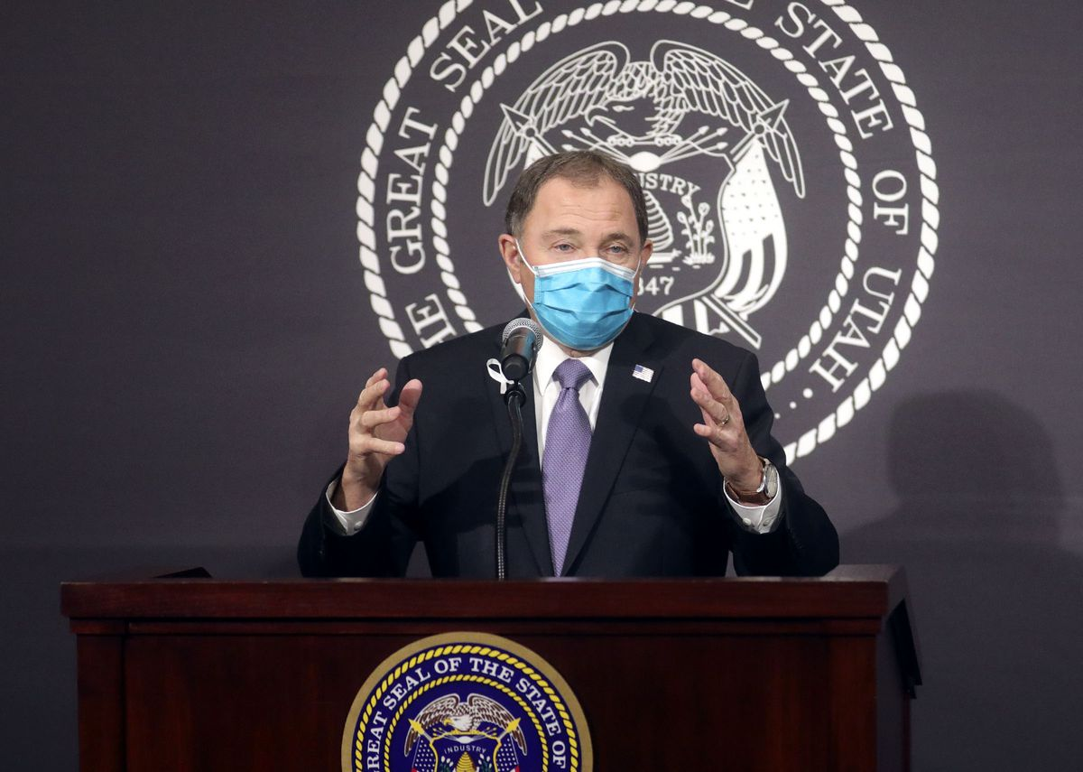 Gov. Gary Herbert wears a face mask during the daily COVID-19 media briefing at the Capitol in Salt Lake City on Tuesday, April 7, 2020. He later took it off to speak more clearly.
