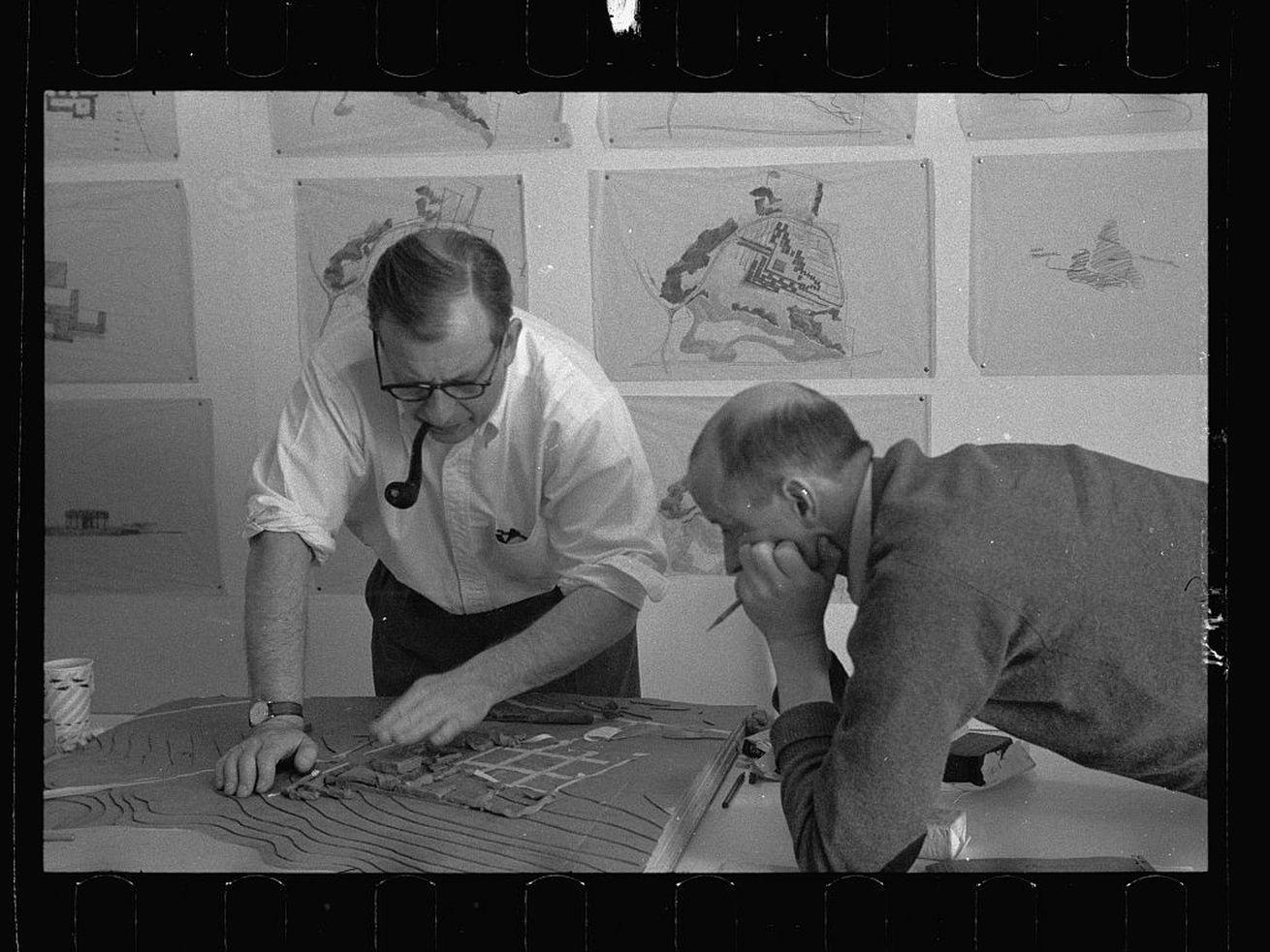 Eero Saarinen, with his ever-present pipe, working with Kevin Roche at Saarinen and Associates in 1953.