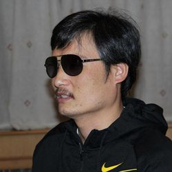 In this photo taken in late April, 2012, and released by Zeng Jinyan, blind Chinese legal activist Chen Guangcheng is seen at an undisclosed location in Beijing during a meeting with human rights activists Hu Jia and Zeng Jinyan. Chen, an inspirational figure in China's rights movement, slipped away from his well-guarded rural village on April 22, 2012, and made it to a secret location in Beijing on Friday, April 27. Activists say he is under the protection of U.S. diplomats in Beijing.
