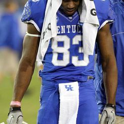 Kentucky's DeMarcus Sweat leaves the field after his team was defeated 32-31 by Western Kentucky in overtime of an NCAA college football game at Commonwealth Stadium in Lexington, Ky., Saturday, Sept. 15, 2012.