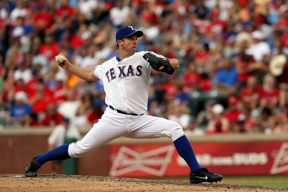 ARLINGTON, TX - JULY 08:  Roy Oswalt #44 of the Texas Rangers throws against the Minnesota Twins at Rangers Ballpark in Arlington on July 8, 2012 in Arlington, Texas.  (Photo by Ronald Martinez/Getty Images)