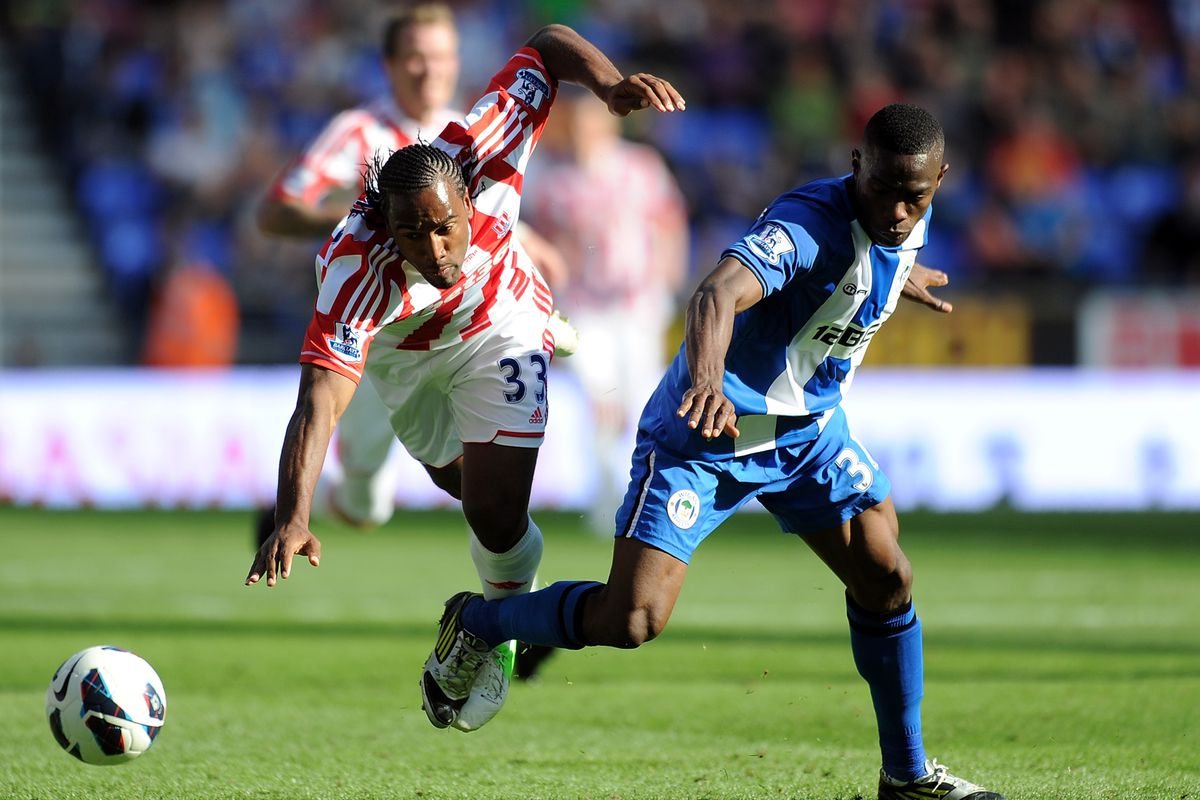 Maynor Figueroa of Wigan Athletic tackles Cameron Jerome of Stoke City during the Barclays Premier League match between Wigan Athletic and Stoke City at DW Stadium.