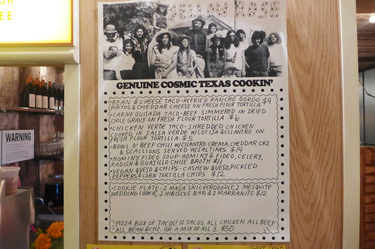 A hand lettered menu with a photo of Texas hippies, some with hats, above.