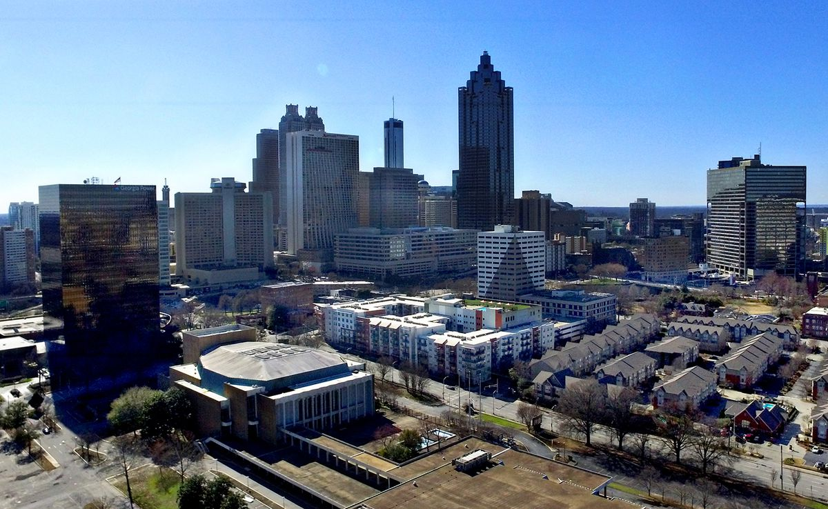 A drone photo of downtown Atlanta, with a black building at left.