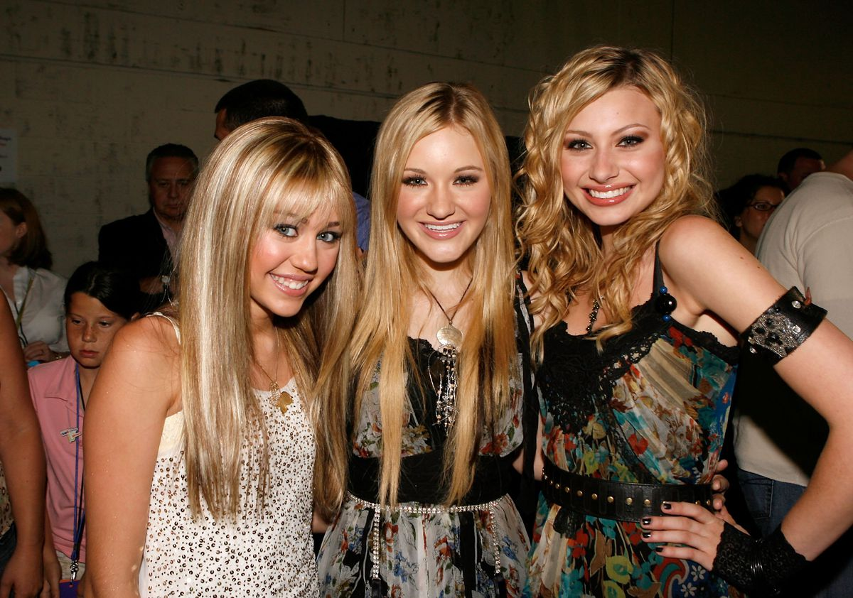 Miley Cyrus, AJ, and Aly backstage at a Radio Disney concert in 2006.