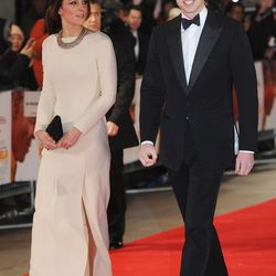 Walking the red carpet on December 5th, 2013 in a Roland Mouret gown.