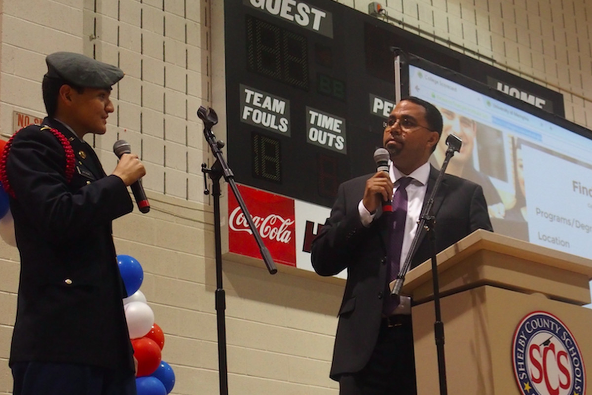 U.S. Education Secretary John B. King Jr. and Craigmont High School senior Kevin Mathews demonstrate how to use the U.S. Department of Education's College Scorecard, which helps students and parents sift through information about colleges. King visited Memphis Wednesday as part of the department's back-to-school bus tour.