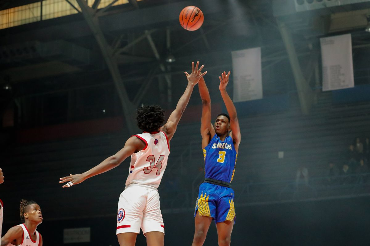 Simeon's Jeremiah Williams (3) shoots the ball over Curie's Jermel Grigsby (34).