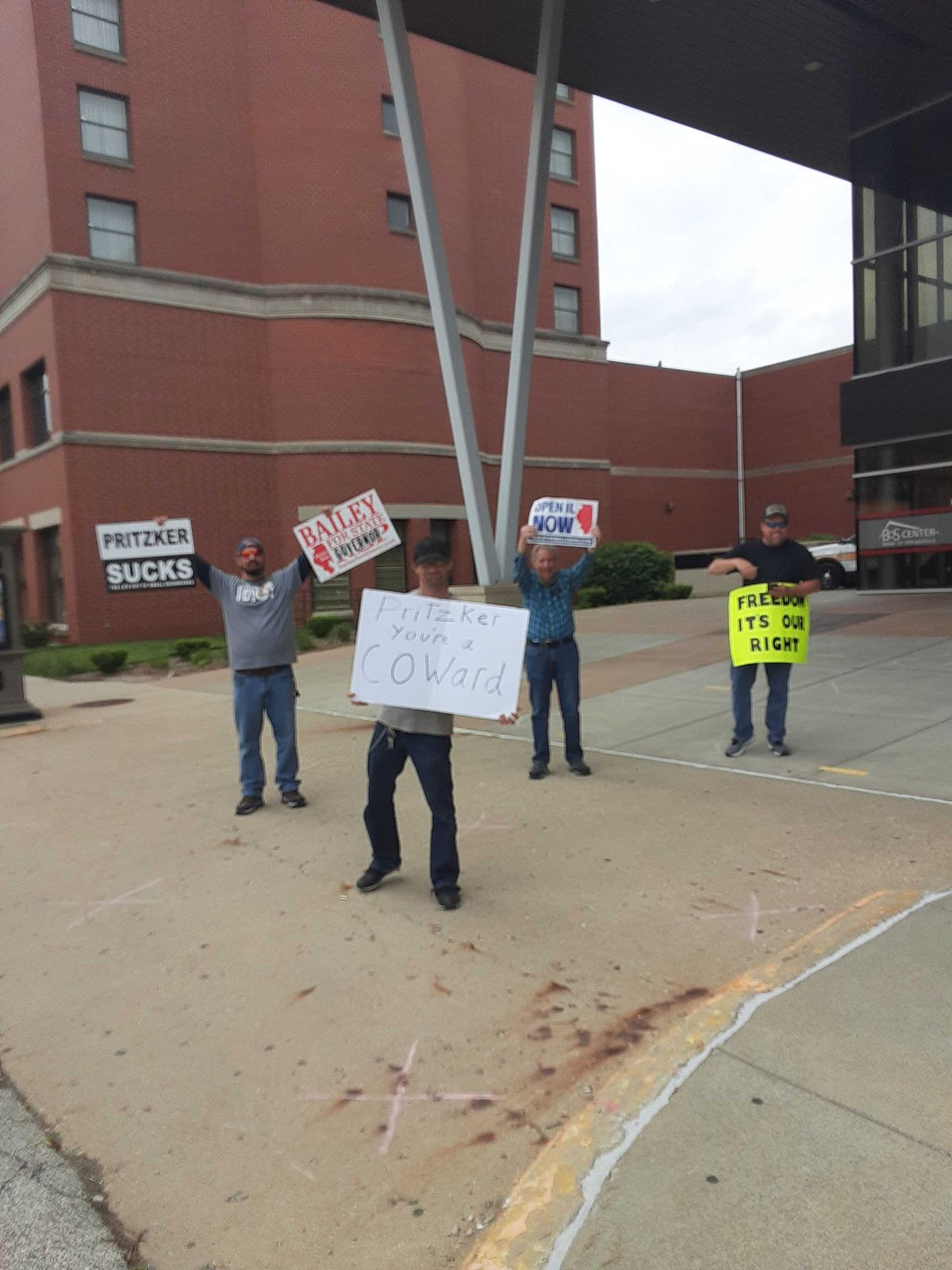 A handful or protesters demonstrate outside the Bank of Springfield Center on Day Two of the special legislative session.