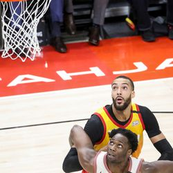 Utah Jazz center Rudy Gobert (27) and Portland Trail Blazers forward Caleb Swanigan (50) watch for the rebound at Vivint Smart Home Arena in Salt Lake City on Friday, Feb. 7, 2020.