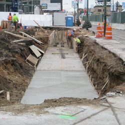 Another sidewalk/path being constructed in the triangle lot near the corner of Clark & Waveland