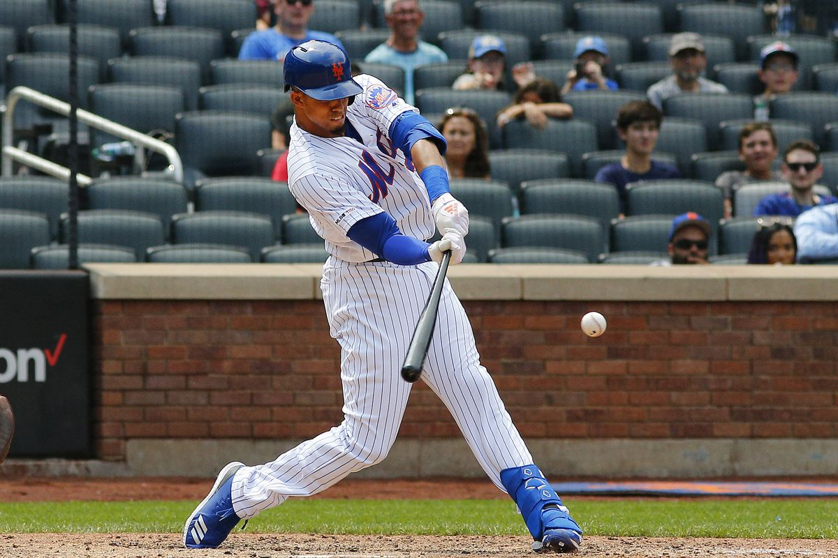New York Mets center fielder Aaron Altherr doubles against the Miami Marlins during the seventh inning at Citi Field.