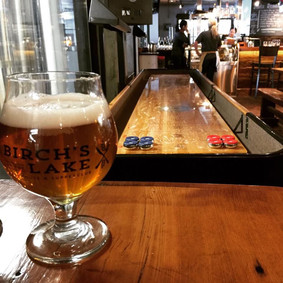 Beer and shuffleboard at Birch's. Photo courtesy Birch's on the Lake Facebook page