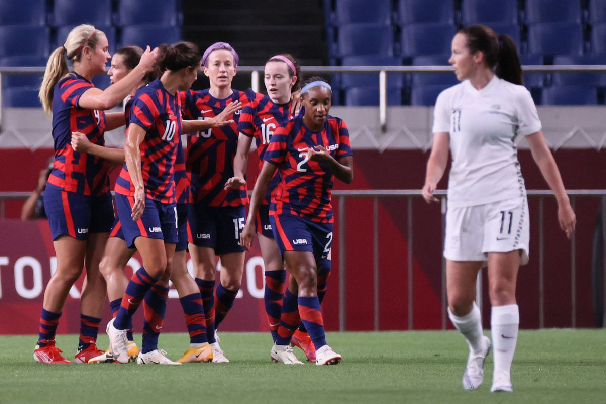 USA's players celebrate their opening goal during the Tokyo 2020 Olympic Games women's group G first round football match between New Zealand and USA at the Saitama Stadium in Saitama on July 24, 2021.