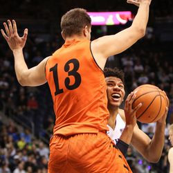 After pulling in the pass, Brigham Young Cougars forward Yoeli Childs attempts to shoot under Idaho State Bengals guard Houston Wahlen as BYU takes on Idaho State at the Marriott Center in Provo on Thursday, Dec. 21, 2017.