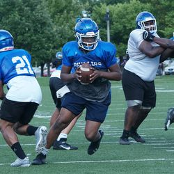 Phillips quarterback Terryon Thrower rolls out for a pass in practice.